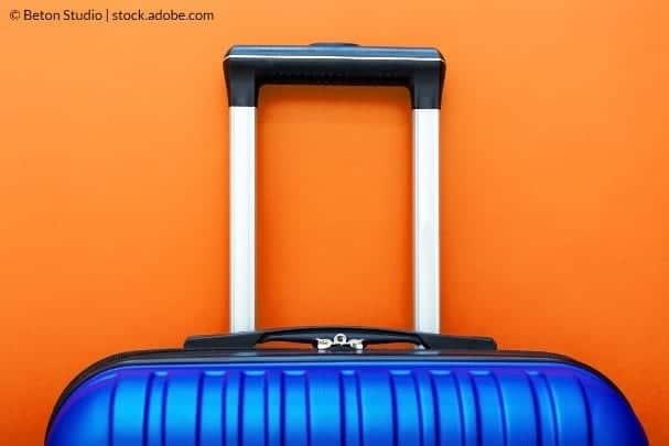 Hvordan du reparer en kuffert på hjul