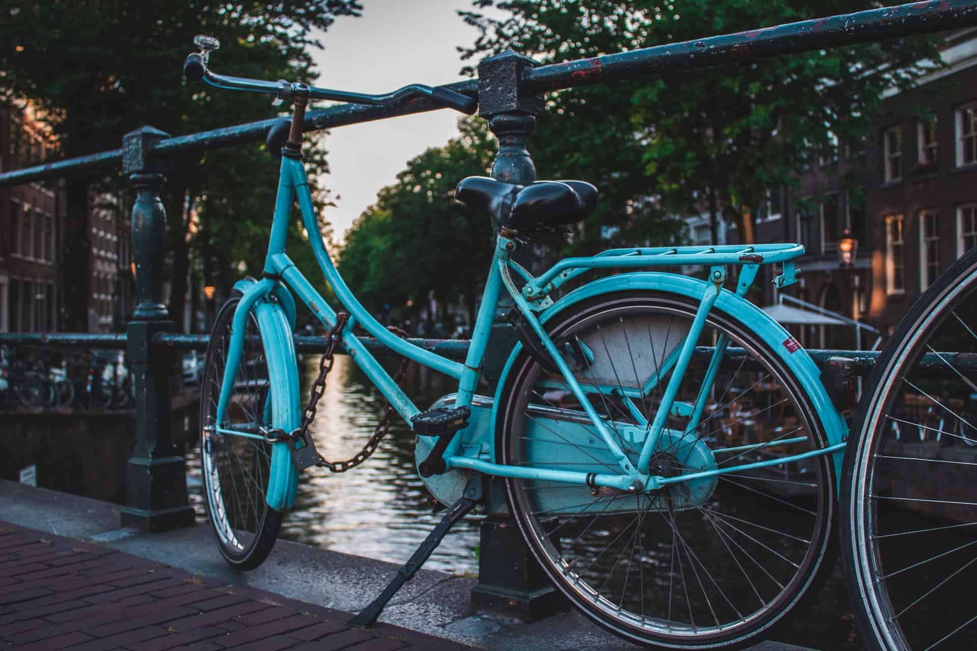 canva blue cruiser bicycle near river