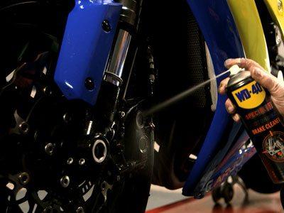 WD-40 Specialist Motorbike Brake cleaner being used to clean motorbike breaks