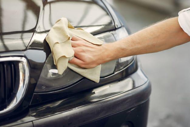 man white shirt wipes car car wash 1157 27236