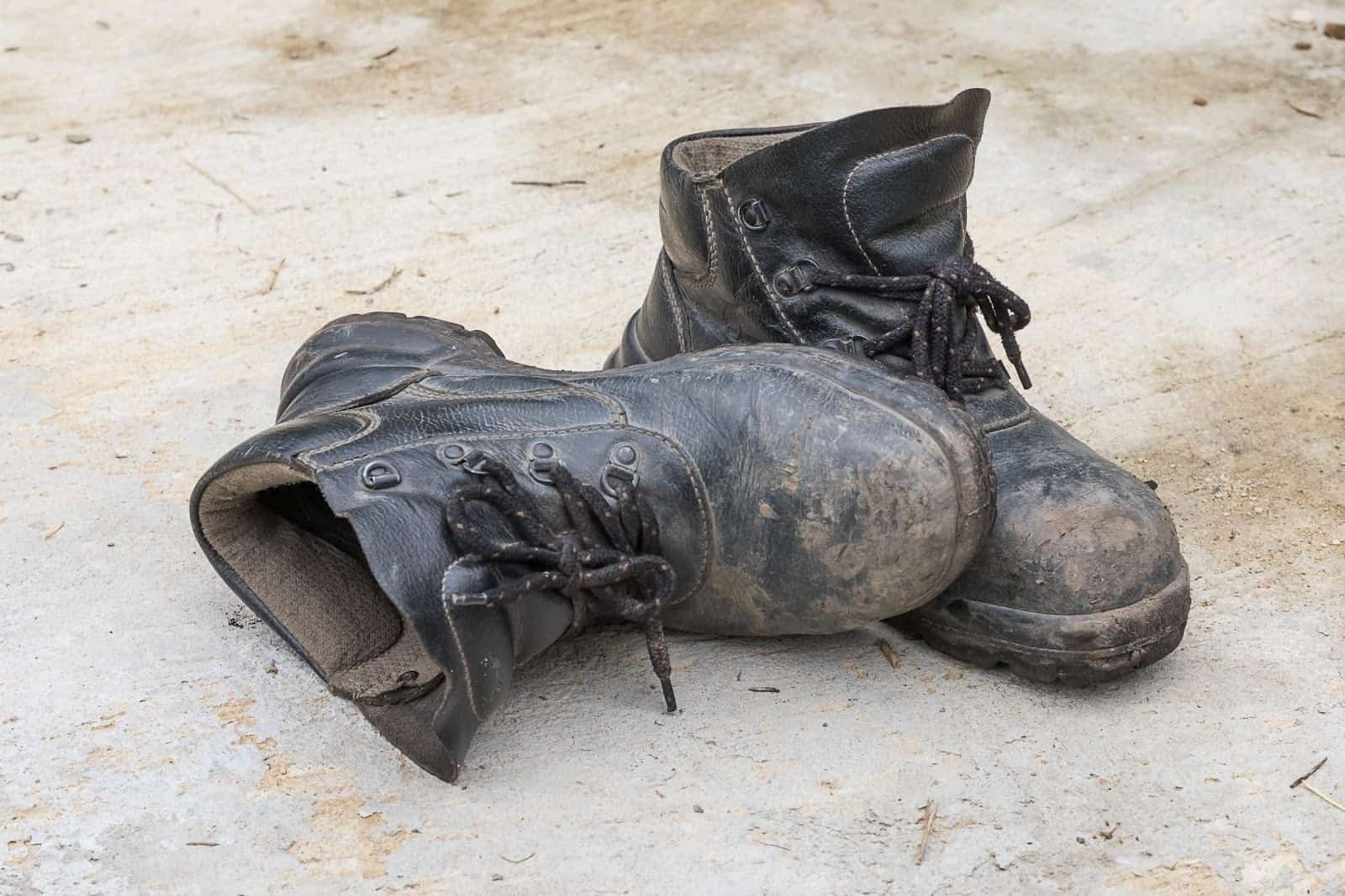 cleaning mud away from shoes in monsoon