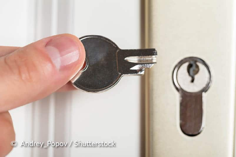 Draai het slot in de vergrendelde of ontgrendelde positie